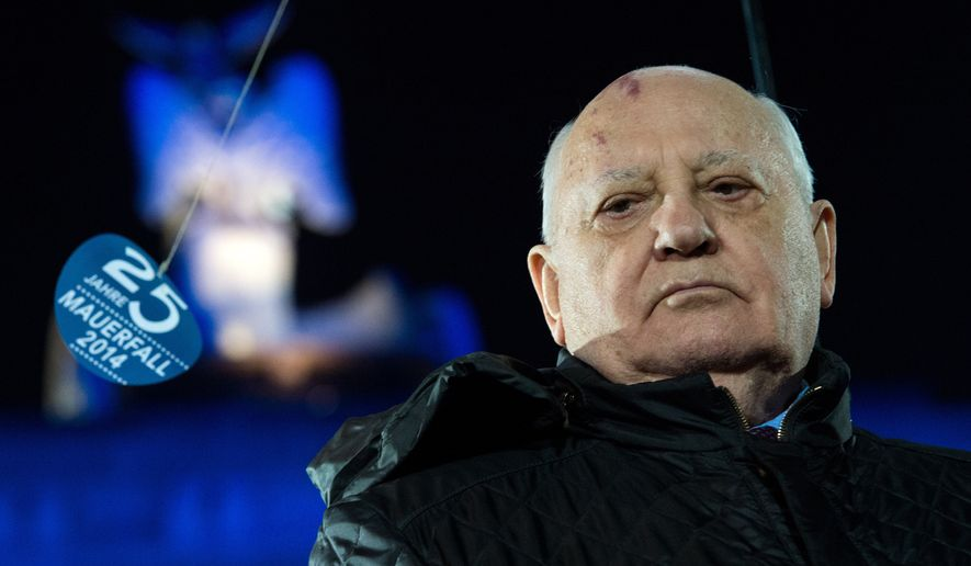 Former leader of the Soviet Union Mikhail Gorbachev takes part in the celebration on the occasion of the 25th anniversary of the fall of the Berlin Wall in front of the Brandenburg Gate in Berlin, Germany, Nov. 9,  2014. Numerous events are taking place in Berlin to commemorate the 25th anniversary of the fall of the Berlin Wall. (AP Photo/dpa, Bernd von Jutrczenka) ** FILE **