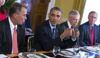 FILE - In this Nov. 7, 2014 file photo, President Barack Obama meets with Congressional leaders in the Old Family Dining Room of the White House in Washington. From left are, House Speaker John Boehner of Ohio, Obama, Senate Majority Leader Harry Reid of Nev., and Senate Minority Leader Mitch McConnell of Ky. Republican leaders and President Barack Obama say the message of the midterm elections is clear: Voters want them to work together. But on what? The two parties' voters, like their politicians, are far apart on health care, immigration and climate change, exit polls show. The voters can't even agree on whether the economy is looking worse or getting better.(AP Photo/Evan Vucci, File)