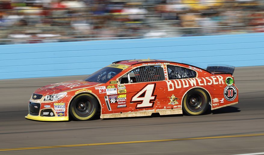 Kevin Harvick drives out of turn four during the Quicken Loans Race for Heroes 500 NASCAR Sprint Cup Series auto race at Phoenix International Raceway, Sunday, Nov. 9, 2014, in Avondale, Ariz. (AP Photo/Ralph Freso)