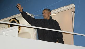 President Barack Obama waves as he boards Air Force One Sunday en route to the Asia-Pacific region for a week of international summits. (AP Photo/Pablo Martinez Monsivais)