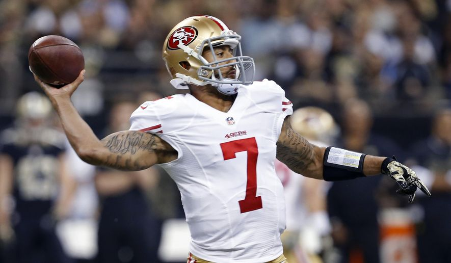 San Francisco 49ers quarterback Colin Kaepernick (7) passes in the first half of an NFL football game against the New Orleans Saints in New Orleans, Sunday, Nov. 9, 2014. (AP Photo/Jonathan Bachman)