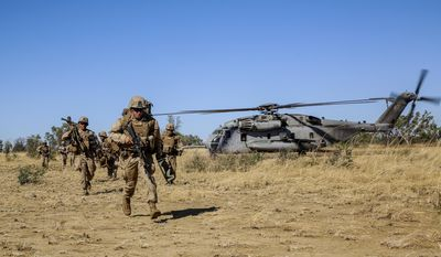 Marines with Bravo Company, 1st Battalion, 5th Marine Regiment, Marine Rotational Force-Darwin conduct a helicopter insert during a live-fire exercise at Bradshaw Field Training Area during Exercise Koolendong, August 2014. The focus of Exercise Koolendong 2014 is to establish a 4th Marines and Australian Defence Force combined headquarters element, directing ground, aviation and logistics capabilities in austere conditions, employing all maneuver elements in execution of the exercise.