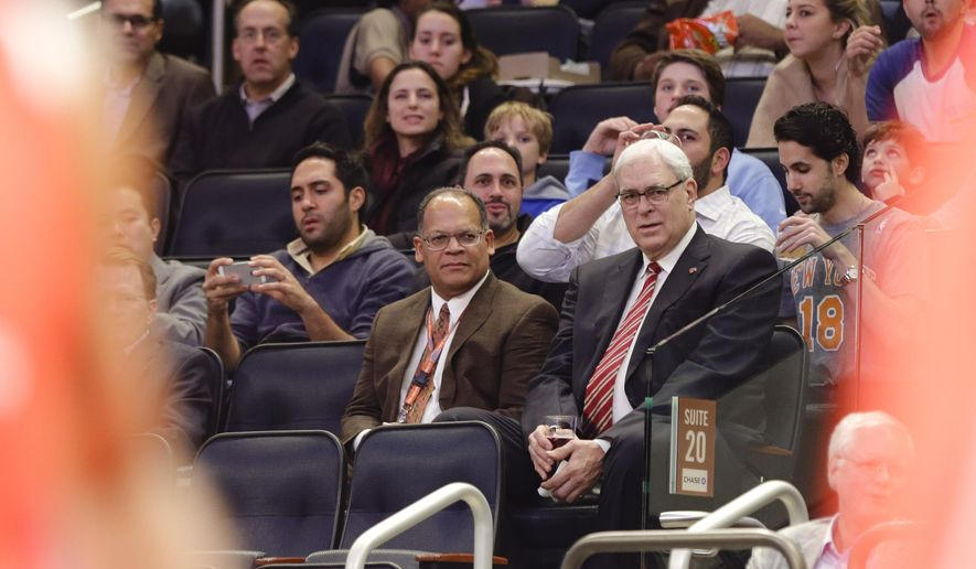 New York Knicks president Phil Jackson watches during the first half of an NBA basketball game against the Atlanta Hawks Monday, Nov. 10, 2014, in New York.  (AP Photo/Frank Franklin II)