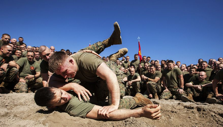 Marines assigned to Battalion Landing Team, 3rd Battalion, 2nd Marine Regiment, conduct a Marine Corps Martial Arts grappling session during a motivational run on Onslow Beach, N.C., March 4, 2013. BLT 3/2, the ground combat element of the 26th Marine Expeditionary Unit, conducted the run to generate esprit de corps and enhance unit cohesion before embarking on their deployment this month.(U.S. Marine Corps photo by Cpl. Christopher Q. Stone)