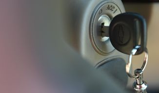 This April 1, 2014, file photo shows the ignition switch of a 2005 Chevrolet Cobalt in Alexandria, Va. Emails released Monday, Nov. 10, 2014 from a court case show that General Motors Co. ordered 500,000 replacement ignition switches almost two months before telling government safety regulators that the switches would be recalled. (AP Photo/Molly Riley, File)