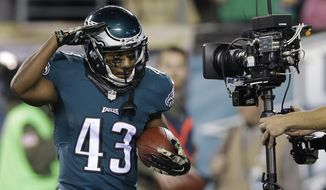Philadelphia Eagles' Darren Sproles celebrates after scoring a touchdown during the first half of Monday night's game against the Carolina Panthers in Philadelphia. (Associated Press)