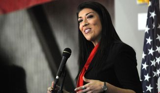 In this March 1, 2014 file photo assemblywoman Lucy Flores announces her candidacy for lieutenant governor of Nevada during an event at the College of Southern Nevada's Cheyenne campus in North Las Vegas. (AP Photo/Las Vegas Review-Journal, Erik Verduzco,File)