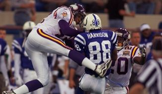 Minnesota Vikings safety Orlando Thomas, left, attempts to break up a pass to Indianapolis Colts wide receiver Marvin Harrison, center, as Vikings cornerback Kenny Wright looks on during the first play of the game Thursday, Aug 24, 2000, in Indianapolis Thursday, Aug. 24, 2000. Harrison made the catch for a 35-yard gain. (AP Photo/Michael Conroy)