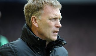 Manchester United's manager David Moyes looks on during their English Premier League soccer match against Everton at Goodison Park in Liverpool, England, Sunday April 20, 2014. (AP Photo/Clint Hughes)