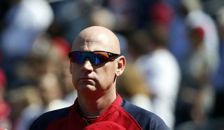 Washington Nationals manager Matt Williams (9) stands during the National Anthem before the first baseball game of a doubleheader against the Miami Marlins at Nationals Park, Friday, Sept. 26, 2014, in Washington. (AP Photo/Alex Brandon)