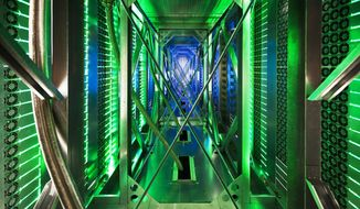 In this undated file photo made available by Google, hundreds of fans funnel hot air from the computer servers into a cooling unit to be recirculated at a Google data center in Mayes County, Okla. (AP Photo/Google, Connie Zhou, File) ** FILE **