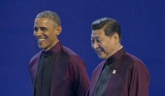 U.S. President Barack Obama, left, and Chinese President Xi Jinping walk during the Asia-Pacific Economic Cooperation (APEC) Summit family photo, Monday, Nov. 10, 2014 in Beijing. Obama is in China to attend the Asia-Pacific Economic Cooperation (APEC) Summit. (AP Photo/Pablo Martinez Monsivais)