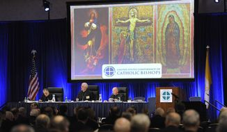 Left to right, Archbishop Daniel N. DiNardo vice president, of Galveston-Houston, Archbishop Joseph E. Kurtz, president, of Louisville, and the Rev. Ronny Jenkins, general secretary of the U.S. Conference of Catholic Bishops, lead a general meeting of the conference during its annual fall meeting in Baltimore Monday, Nov. 10, 2014. (AP Photo/Steve Ruark)