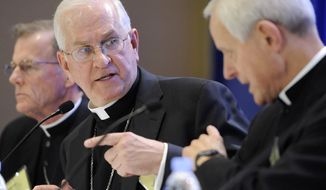 From left, Bishop John C. Wester of Salt Lake City, Archbishop Joseph E. Kurtz of Louisville, Ky., president of the U.S. Conference of Catholic Bishops, and Cardinal Donald W. Wuerl, Archbishop of Washington, address reporters at a news conference during the conference's annual fall meeting in Baltimore Monday, Nov. 10, 2014. (AP Photo/Steve Ruark) **FILE**