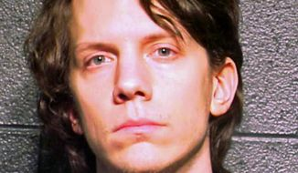 This March 5, 2012, file photo provided by the Cook County Sheriff's Department in Chicago shows Jeremy Hammond. Once the FBI's most-wanted cybercriminal, Hammond is serving one of the longest sentences a U.S. hacker has received, 10 years, the maximum allowed under his plea agreement last year. (AP Photo/Cook County Sheriff's Department, File)