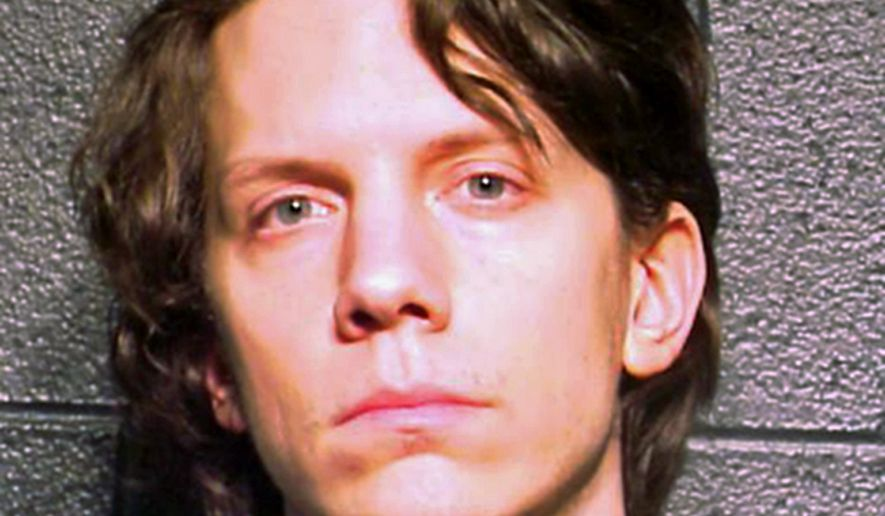 FILE - This March 5, 2012 file photo provided by the Cook County Sheriff's Department in Chicago shows Jeremy Hammond. Once the FBI's most-wanted cybercriminal, Hammond is serving one of the longest sentences a U.S. hacker has received, 10 years, the maximum allowed under his plea agreement last year. (AP Photo/Cook County Sheriff's Department, File)
