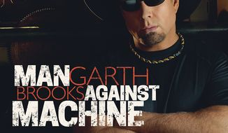 "This CD cover image released by Sony Music Nashville shows ""Man Against Machine,"" by Garth Brooks. (AP Photo/Sony Music Nashville)"