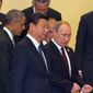 President Obama joins Philippine President Benigno Aquino III (second right), Chinese President Xi Jinping and Russian President Vladimir Putin at the Asia-Pacific Economic Cooperation summit Tuesday in Beijing. (Associated Press)