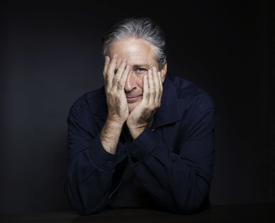 """In this Nov. 7, 2014 photo, Jon Stewart poses for a portrait in promotion of his film,""""Rosewater,"""" in New York. Stewart, who hosts the political satire series """"The Daily Show with Jon Stewart,"""" makes his directorial and screenwriting debut in the film about a journalist who is detained in Iran. (Photo by Victoria Will/Invision/AP)"""