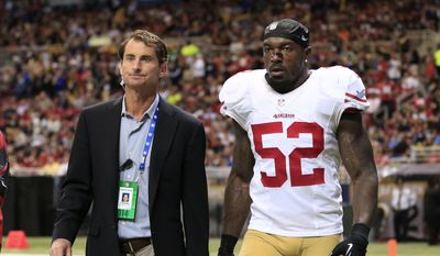 San Francisco 49ers inside linebacker Patrick Willis (52) leaves the field after being injured in the second quarter of an NFL football game against the St. Louis Rams Monday, Oct. 13, 2014, in St Louis. (AP Photo/Billy Hurst)