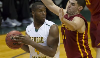 George Mason forward Erik Copes (4) looks for an open teammate to pass to while being defended by Iowa State forward Georges Niang (31) in the first half of an NCAA college basketball game at the Diamond Head Classic Sunday, Dec. 22, 2013, in Honolulu. (AP Photo/Eugene Tanner)