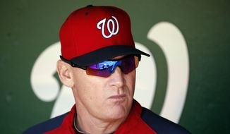Washington Nationals manager Matt Williams (9) pauses in the dugout before during a baseball game against the Philadelphia Phillies at Nationals Park, Sunday, Sept. 7, 2014, in Washington. (AP Photo/Alex Brandon)