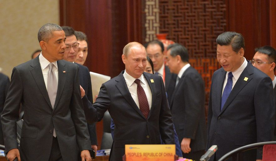 President Obama, Russian President Vladimir Putin and Chinese President Xi Jinping at the Asia-Pacific Economic Cooperation (APEC) Summit on Nov. 11, 2014, in Beijing. (AP Photo/RIA Novosti, Presidential Press Service)