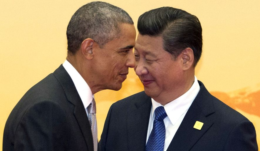 U.S. President Barack Obama, left, walks past Chinese President Xi Jinping during a welcome ceremony for the Asia-Pacific Economic Cooperation (APEC) summit at the International Convention Center in Yanqi Lake, Beijing, China Tuesday, Nov. 11, 2014. (AP Photo/Ng Han Guan) **FILE**