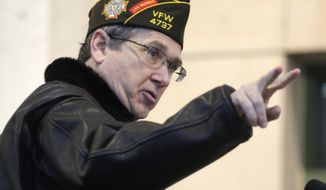 Sen. Mark Kirk, Illinois Republican, speaks at a Veterans Day commemoration ceremony at Soldier Field in Chicago on Nov. 11, 2014. (Associated Press) **FILE**