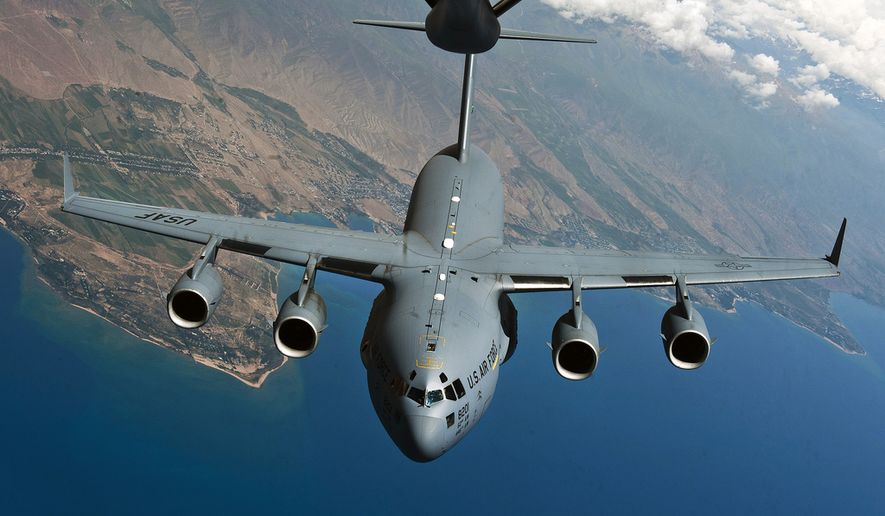 A U.S. Air Force C-17 Globemaster III cargo aircraft prepares to demonstrate aerial refueling capabilities during an aerial refueling demonstration over Kyrgyzstan, June 8, 2012. The C-17's primary mission is to transport personnel and cargo into and out of the area of responsibility. (U.S. Air Force photo by Senior Airman Brett Clashman) ** FILE **