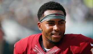 FILE - This is a Sept. 21, 2014, file photo showing Washington Redskins' DeSean Jackson walking the sidelines during the second half of an NFL football game against the Philadelphia Eagles in Philadelphia. Jackson sensed that perhaps not all of his Redskins teammates were supportive of Robert Griffin III. So last week, before the team broke for the bye, the talented but usually quiet veteran receiver raised some eyebrows when he stood up at the end of a full team meeting in the Redskins Park auditorium. Jackson made a quick speech stressing that everyone needs to unite behind the coaches' decision and support the quarterback.  (AP Photo/Matt Rourke, File)