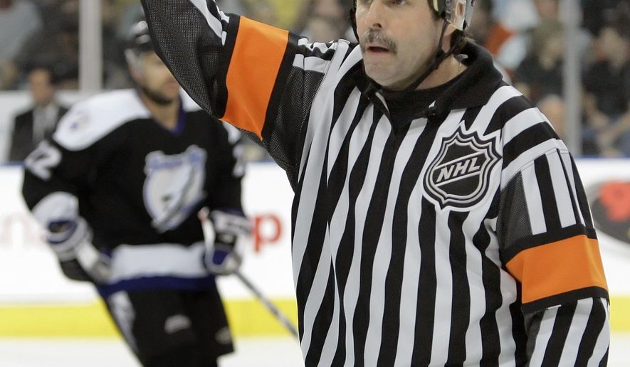 """FILE - In this Oct. 19, 2006, file photo, NHL referee Bill McCreary officiates during an NHL hockey game between the Philadelphia Flyers and Tampa Bay Lightning in Tampa, Fla. McCreary admits he made """"hundreds and hundreds"""" of mistakes during his career as an NHL referee. But he also produced a body of exceptional work and will be honored next week when he enters the Hockey Hall of Fame. He will be the 16th official in the hall.  (AP Photo/Chris O'Meara, File)"""