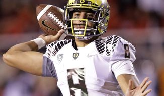 Oregon quarterback Marcus Mariota (8) passes the ball in the second half during an NCAA college football game against Utah Saturday, Nov. 8, 2014, in Salt Lake City. (AP Photo/Rick Bowmer)
