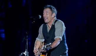 Bruce Springsteen performs on the National Mall in Washington, Tuesday, Nov. 11, 2014, during the Concert for Valor. The Veterans Day event is hosted by HBO, Starbucks and Chase and is free and open to the public. (AP Photo/Carolyn Kaster)