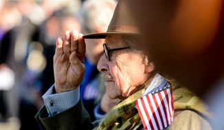 A veteran salutes during a Veterans Day commemoration at the World War II Memorial on the morning of Veterans Day, Washington, D.C., Tuesday, November 11, 2014. The event was hosted by the Friends of the World War II Memorial, the National Park Service and the Military District of Washington host. (Andrew Harnik/The Washington Times) **FILE**