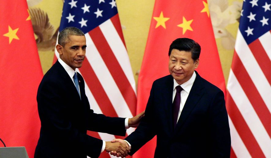 President Obama and Chinese President Xi Jinping announced an unprecedented agreement to limit carbon emissions in an attempt to fight climate change in this 2014 file photo. (Associated Press) **FILE**