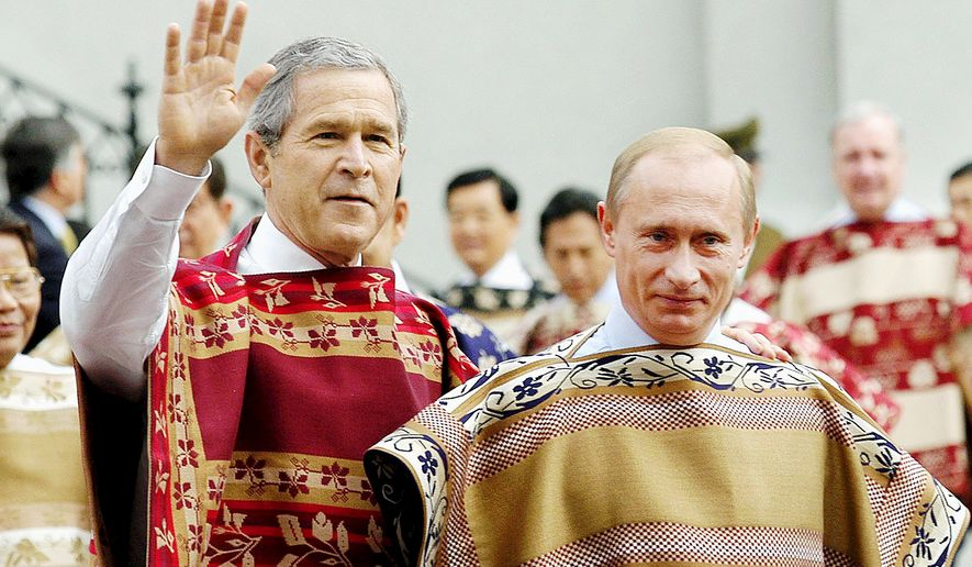 U.S. President Bush, left, and Russian President Vladimir Putin, wearing traditional Chilean ponchos, are seen prior to the leaders' group photo at the 2004 APEC Summit in Santiago, Chile, Sunday, Nov. 21, 2004. (AP Photo/ITAR-TASS, Presidential Press Service) ** FILE **