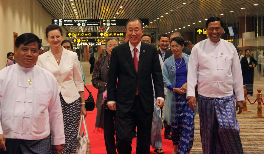 U.N. Secretary General Ban Ki-moon, center right, walks along with Myanmar officials upon his arrival at Naypyitaw International airport to attend the 25th Association of Southeast Asian Nations (ASEAN) summit in Naypyitaw, Myanmar, Tuesday, Nov. 11, 2014. The ASEAN summit will be held in the capital on Nov. 12 and 13. (AP Photo/Khin Maung Win)