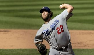 Los Angeles Dodgers starting pitcher Clayton Kershaw delivers during the fifth inning of a baseball game against the Chicago Cubs, Friday, Sept. 19, 2014, in Chicago. (AP Photo/Charles Rex Arbogast)