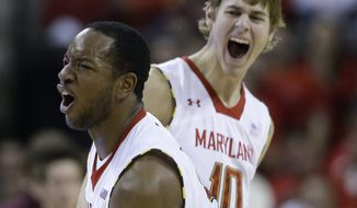 Maryland guards Dez Wells, front, and Jake Layman react after Virginia Tech called a timeout after a three-pointer by Layman in the first half of an NCAA college basketball game in College Park, Md., Saturday, Jan. 5, 2013. (AP Photo/Patrick Semansky)