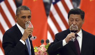 U.S. President Barack Obama, left, and Chinese President Xi Jinping drink a toast at a lunch banquet in the Great Hall of the People in Beijing Wednesday, Nov. 12, 2014. Obama is on a state visit after attending the Asia-Pacific Economic Cooperation (APEC) summit. The United States and China pledged Wednesday to take ambitious action to limit greenhouse gases, aiming to inject fresh momentum into the global fight against climate change ahead of high-stakes climate negotiations next year. (AP Photo/Greg Baker, Pool)
