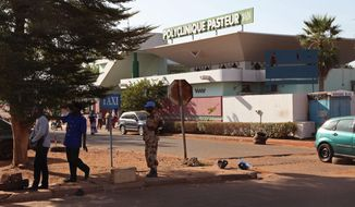 A outside view of the Polyclinique Pasteur clinic where a nurse is suspected of dying from the Ebola virus in the city of Bamako, Mali, Wednesday, Nov. 12, 2014. Malian authorities on Wednesday reported two new deaths from Ebola that are not believed to be linked to the nation's only other known case, an alarming setback as Mali tries to limit the epidemic ravaging other countries in the region. (AP Photo/Baba Ahmed)