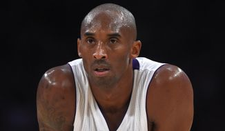 Los Angeles Lakers guard Kobe Bryant looks on during the second half of an NBA basketball game against the Charlotte Hornets, Sunday, Nov. 9, 2014, in Los Angeles. The Lakers won 107-92. (AP Photo/Mark J. Terrill)