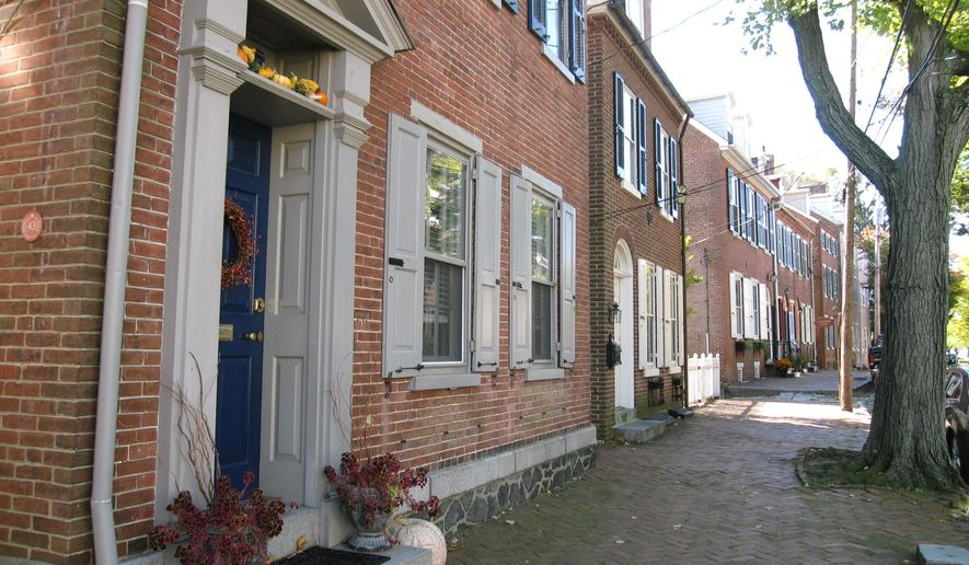 This Oct. 26, 2014 photo shows a quiet residential street in Old New Castle, Del., a 10-minute drive from Wilmington. Old New Castle offers a veritable Who's Who of colonial history with Peter Stuyvesant landing there in 1655, William Penn first setting foot in the New World there in 1682 and the Marquis de Lafayette dropping by to officiate at a wedding in 1824. The charming streetscapes are lined with small brick homes and historic landmarks. (AP Photo/Beth J. Harpaz)