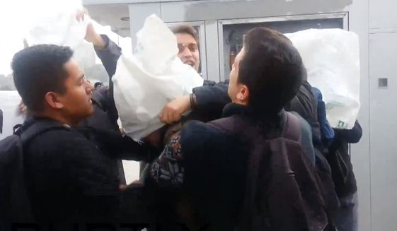An image from a video posted online by the Youth Association of Turkey, a man reported to be a U.S. servicemember, at right, is roughed up by protesters in Istanbul. Image via Youtube