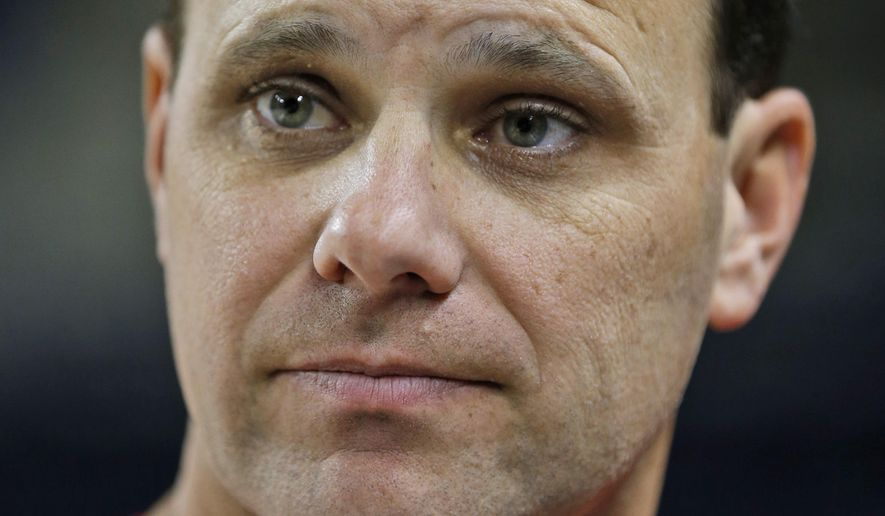 University of Richmond women's basketball coach, Michael Shafer, watches  practice in Richmond, Va., Thursday, Nov. 13, 2014.  Shafer says a day never passes that he doesn't think about Ginny Doyle and Natalie Lewis, the assistant coach and director of basketball operations killed in a fiery balloon crash last May.  (AP Photo/Steve Helber)