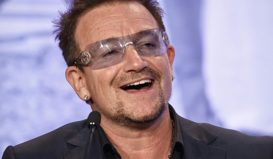 Bono, the Irish rock star and activist, speaks at the Symposium on Global Agriculture and Food Security following an appearance by President Barack Obama at the Ronald Reagan Building in Washington, May 18, 2012. (Associated Press) ** FILE **