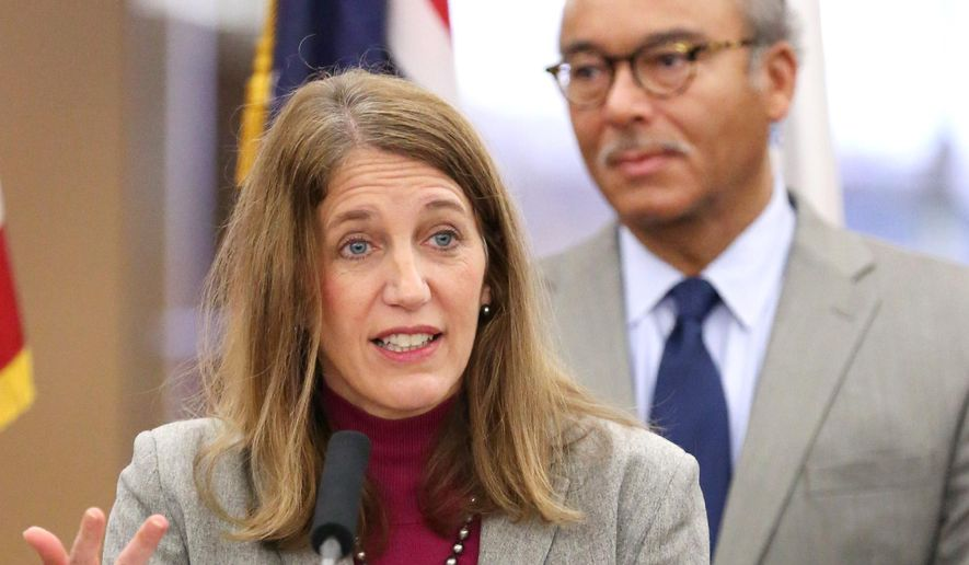 Health and Human Services Secretary Sylvia Burwell talks during a news conference as Columbus Mayor Michael B. Coleman listens on Thursday, Nov.13, 2014 at the Columbus Metropolitan Library in Columbus, Ohio.  Burwell says enrolling in health insurance should be faster and easier for consumers during the second sign-up period for the federal health care law. Officials are hoping to avoid a repeat of last year's website meltdown. Open enrollment under Obama's health overhaul starts Saturday.  (AP Photo/The Columbus Dispatch, Fred Squillante)