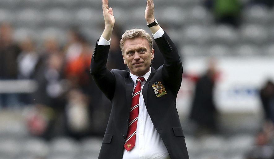 FILE - In this April 5, 2014 file photo, Manchester United manager David Moyes celebrates the team's victory over Newcastle United at the end of their English Premier League soccer match at St James' Park, Newcastle, England. Spanish club Real Sociedad hired Moyes on Monday, Nov. 10, giving the Scotsman a chance to revive his career after his failed stint at Old Trafford. It is Moyes' first coaching assignment since being fired last season after less than a year in charge at United, where he took the top job after Alex Ferguson retired. (AP Photo/Scott Heppell, File)