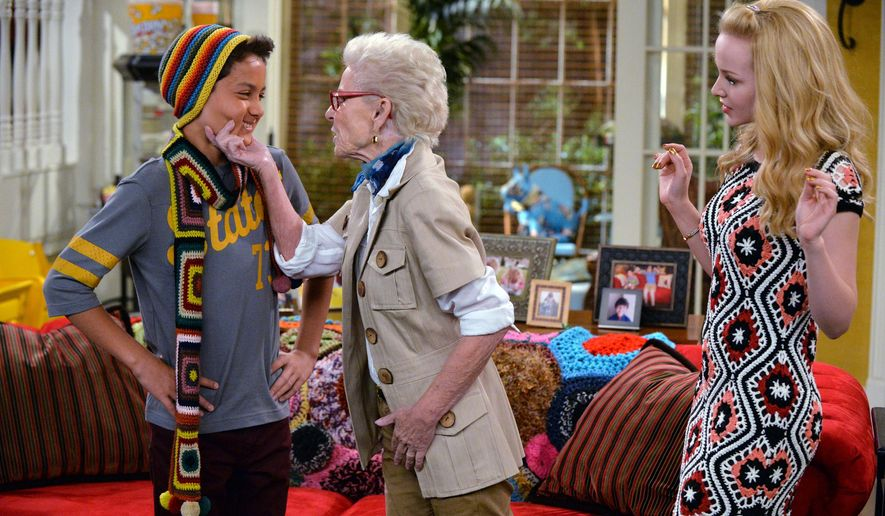 """This photo provided by Disney Channel shows, from left, Tenzing Norgay Trainor, Patty Duke, and Dove Cameron, in a scene from the episode, """"Grandma-A-Rooney"""" on the television series, """"Liv and Maddie.""""  Duke is playing twins on TV again, this time as a pair of grandmas on the Disney Channel. The 67-year-old actress guest stars on the upcoming episode of """"Liv and Maddie,"""" which follows twin sisters played by actress Dove Cameron. (AP Photo/Disney Channel, Eric McCandless)"""